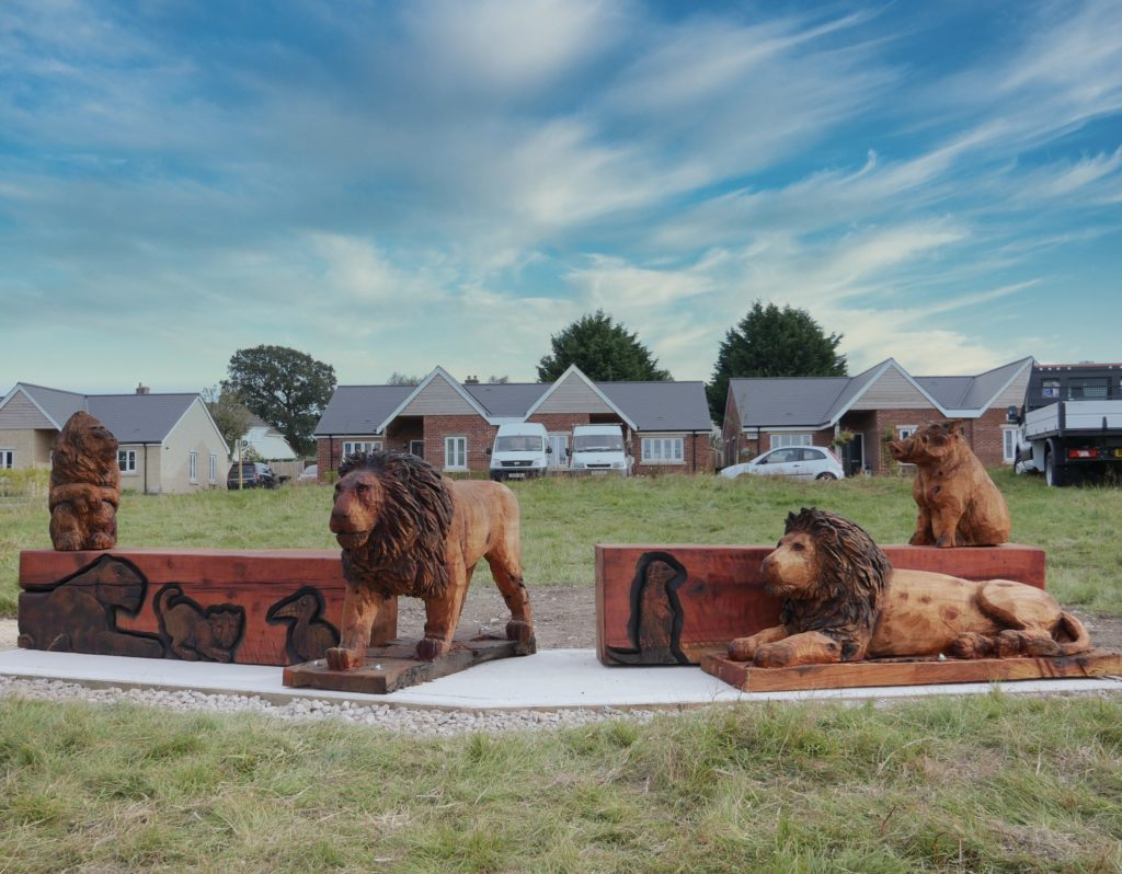 Carved Wooden Benches inspired by the Lion Kingcarved by Neith Chainsaw Carving Artists