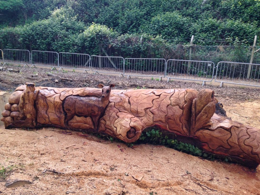A Wildlife Bench carved by Neith Chainsaw Carving Artists