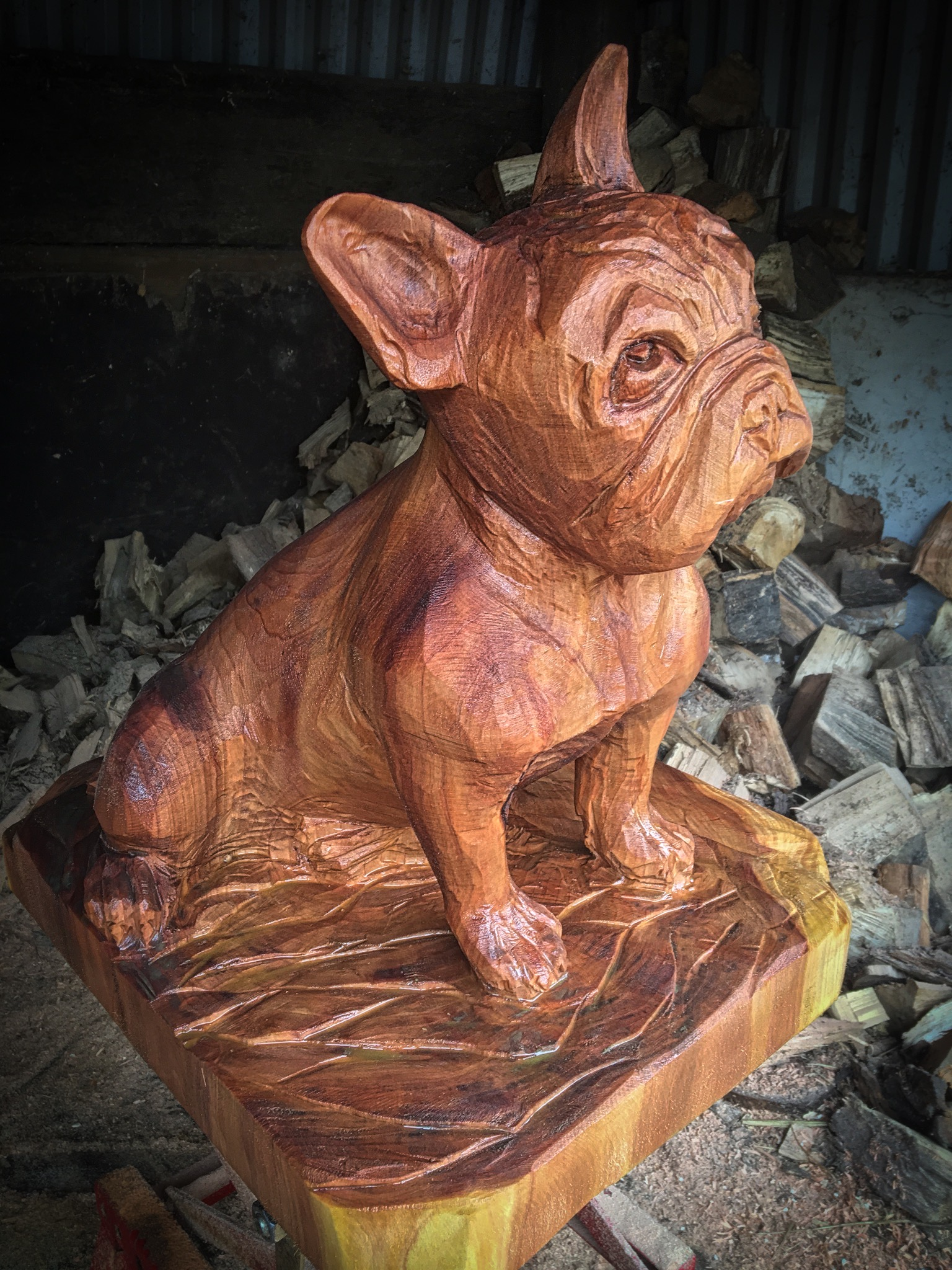 Carving of a French Bulldog carved by Neith Chainsaw Carving Artists