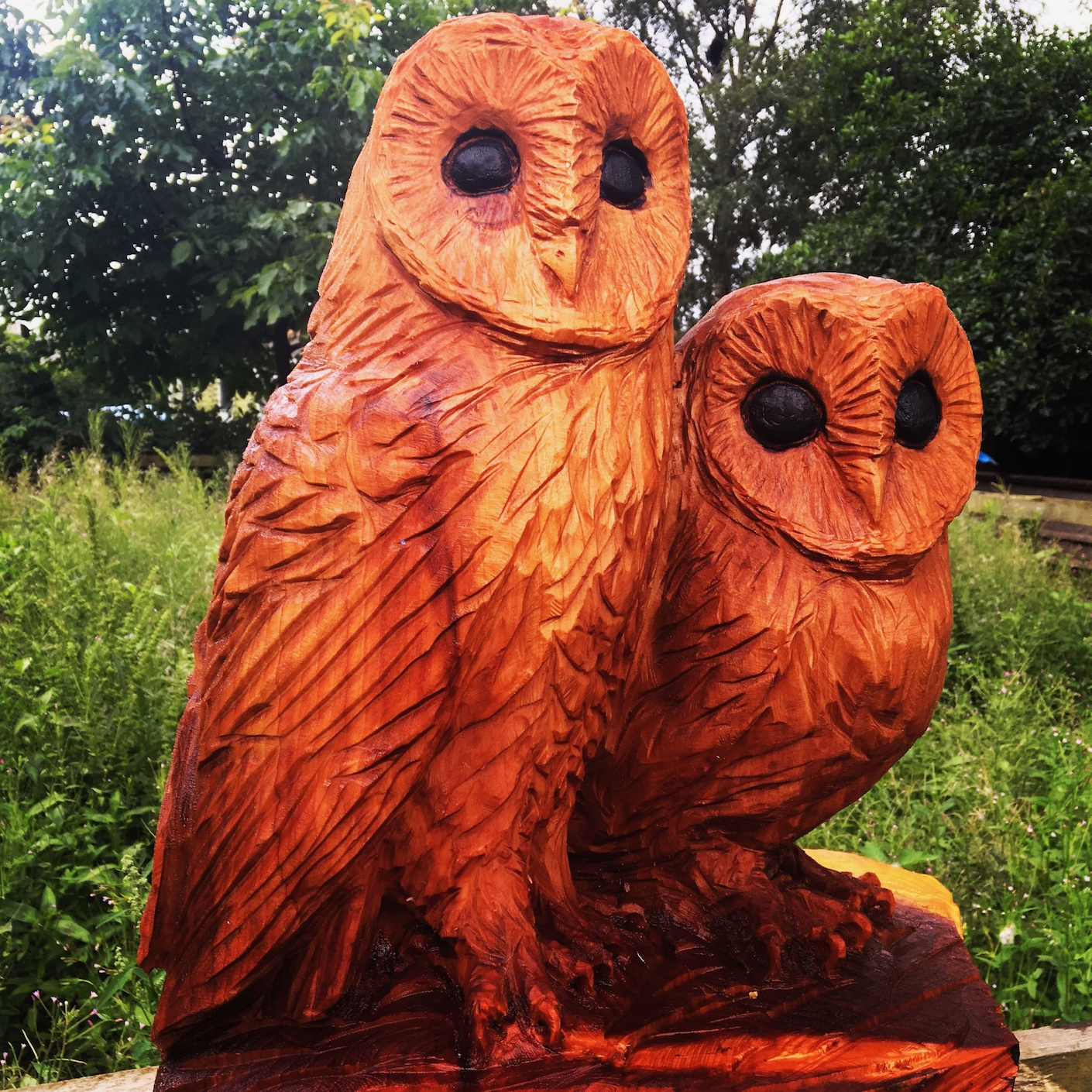 Carving of a pair of Barn Owls carved by Neith Chainsaw Carving Artists