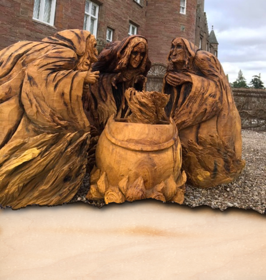 A carving of the Three Witches from Macbeth carved by Neith Chainsaw Carving Artists