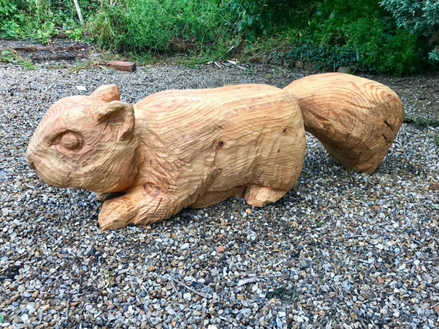 A Squirrel Bench carved by Neith Chainsaw Carving Artists